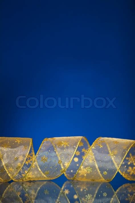 christmas border  gold ribbon  dark blue background  reflection stock photo colourbox
