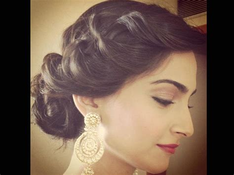 hair cut for long hairs on sari bun hairstyles to steal from sonam kapoor boldsky com