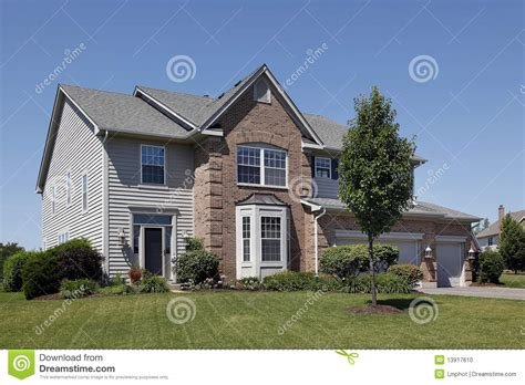 houses with brick and siding home with brown brick and gray siding stock photo image 13917610