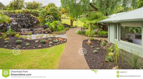 beautiful garden outside of a modern house stock photo
