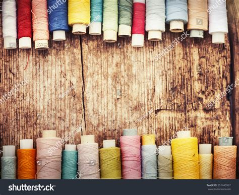 colorful thread wallpaper bobbins colorful threads on old wooden stock photo