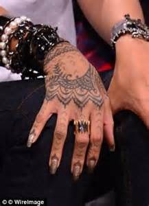 rhianna tattoo henna leaves tourist scarred for
