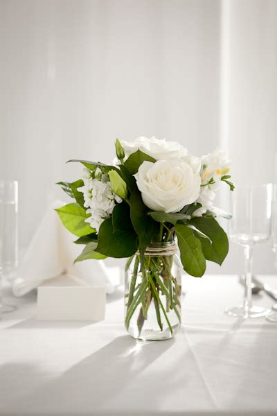 simple flower arrangements for tables simple glass or mason jars can work even outside of the
