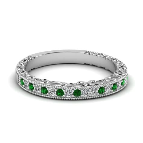 engraved wedding band with emerald in 14k