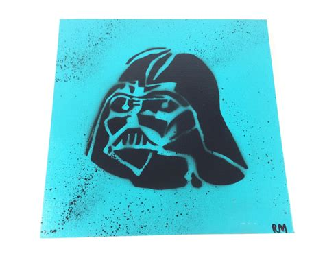 spray paint stencil on canvas covered board by