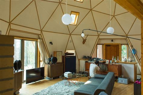 geodesic dome home interior these huts homes and tree houses wear their love for