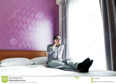 Talk In Bedroom Happy Talking On Mobile Phone In Bedroom Royalty