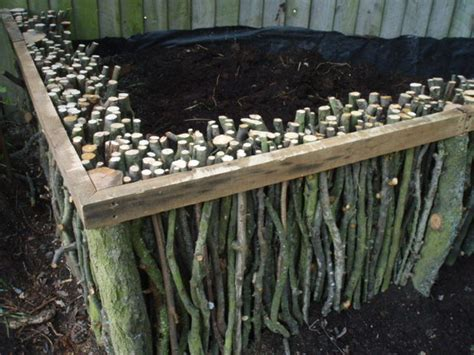 how to fill a raised garden bed diy raised garden bed with branches remodeling expense