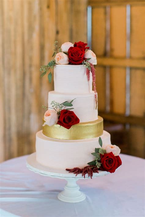 Wedding Cakes With by White Wedding Cake With Burgundy Flowers
