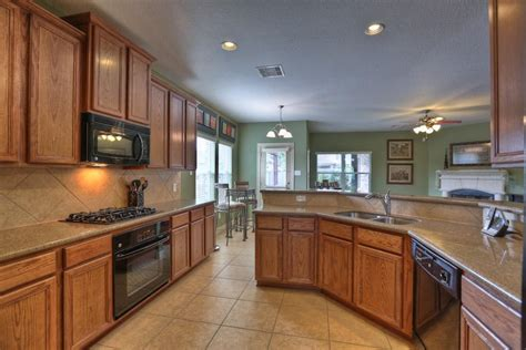 dark tile floor oak cabinets kitchen floor tile cherry cabinets painting oak kitchen cabinets