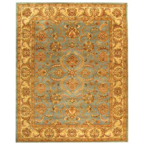 Area Rugs In Blue Safavieh Tufted Heritage Blue Beige Wool Area Rugs Hg811b