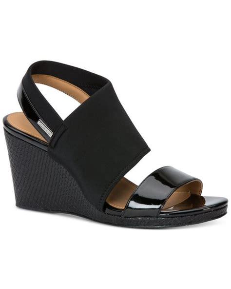 calvin klein wedge sandals calvin klein bryley wedge sandals in black save 12 lyst
