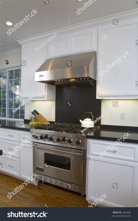stainless steel appliances featuring white kitchen interior shot of a recently remodeled kitchen featuring