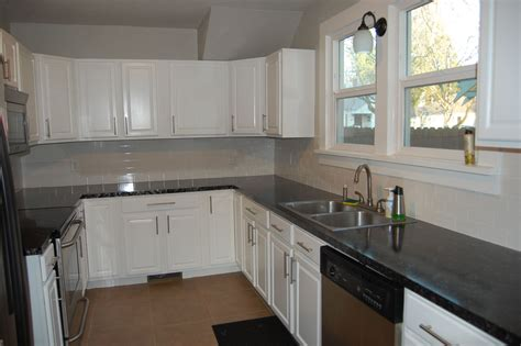 pictures of kitchens with white cabinets and black granite