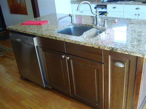 like new granite kitchen island with dishwasher and sink