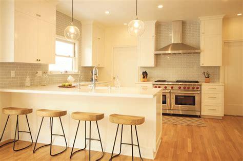 backsplash for ivory kitchen cabinets ivory kitchen cabinets with gray backsplash transitional kitchen blanton interiors
