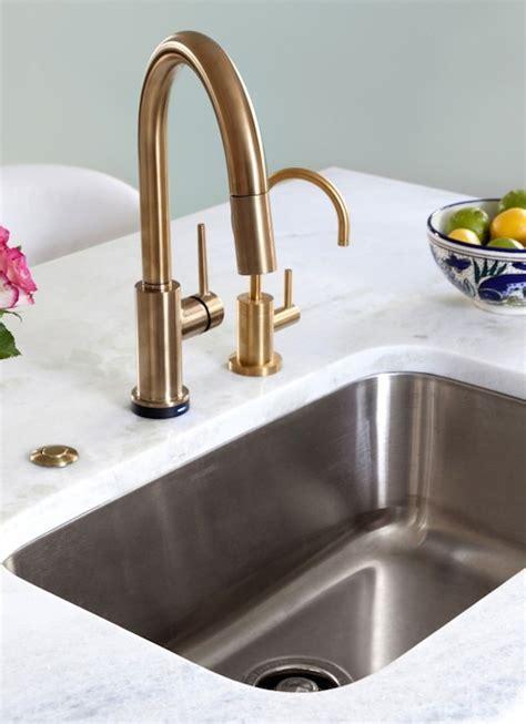 amazing kitchen faucet placement with white countertop rhino white quartzite design ideas