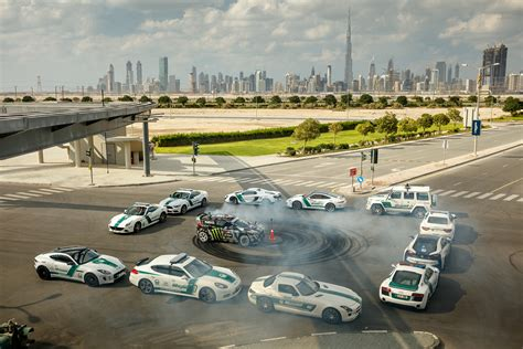 Surrounded by £1.3m worth of police cars, Ken Block stars