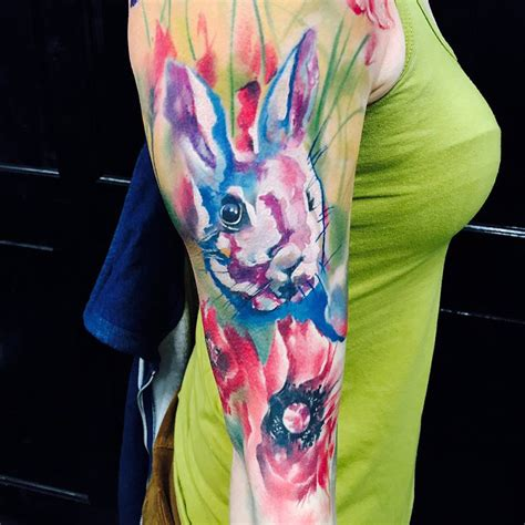 rabbit watercolor tattoo with flowers best tattoo design