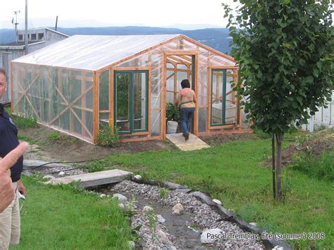 backyard greenhouses canada building greenhouse from recycled windows shelving