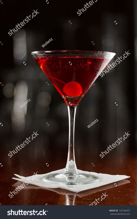 red martini restaurant red cocktail served on busy bar stock photo 132736457