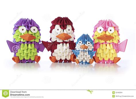 Origami Family - a family of origami penguins stand around stock images