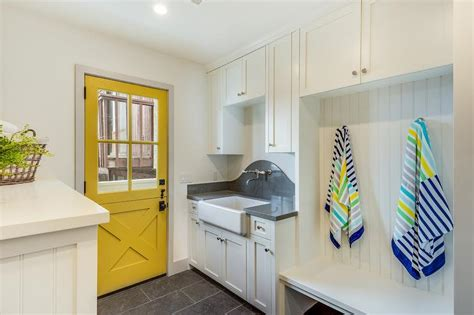 laundry chute doors room beach style with coastal living beach style laundry room and mudroom combo with yellow