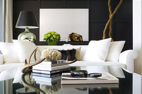 living room with white sofa decorative antlers contemporary living room