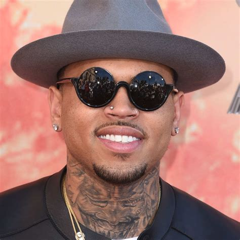 chris brown wanted for allegedly punching man vulture