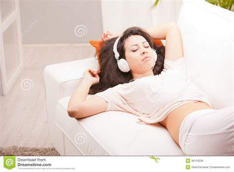 who listens to house music girl listening to music in her house dancing stock photo image 46115536