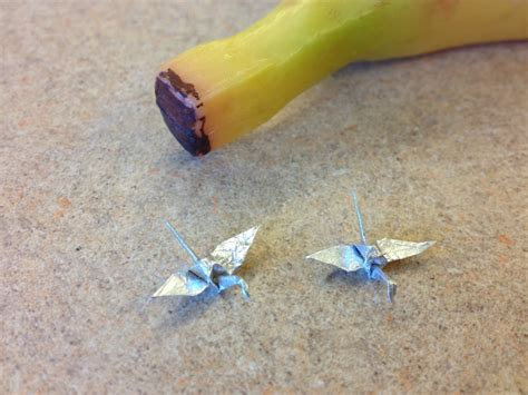 Tin Foil Origami - tiny origami swans made out of tin foil yes that s a