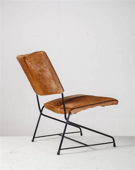 cowhide lounge chair modernist iron and cowhide lounge chair italy 1950s for