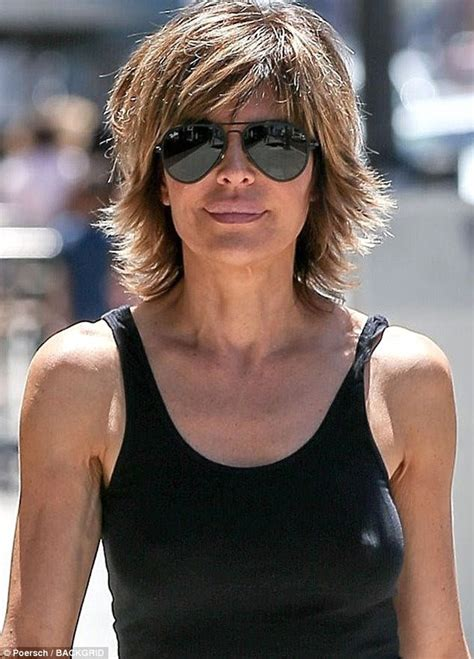 lisa rinna wears vest  ripped jeans  beverly hills