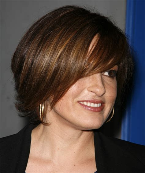 swept back casual haircust mariska hargitay medium straight casual hairstyle with