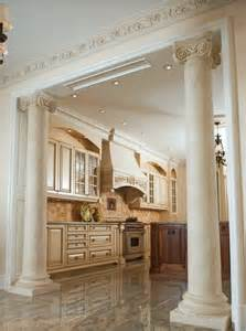 ionic marble columns in kitchen traditional kitchen