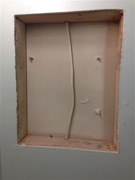 how to install a medicine cabinet on drywall drywall over medicine cabinet doityourself com community