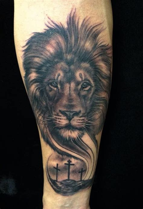 christian lion tattoo and cross by tj yelp tattoos tattoos