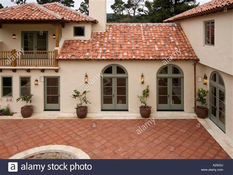 exterior of a style luxury home with stucco walls a tile stock photo royalty free