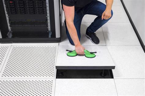 Floor Suction Cups by Computer Engineer Pulling Floor Tile Using Suction Cups In