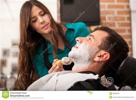 lady barber shaving female barber shaving a man stock photo image 39930620