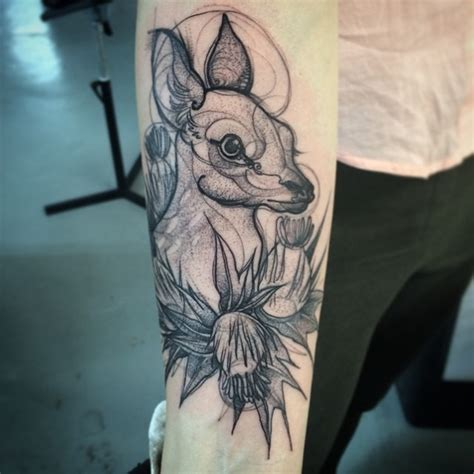 artist makes tattoos that look like pencil drawings