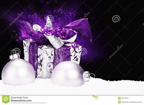 purple christmas present  snow royalty  stock photography image