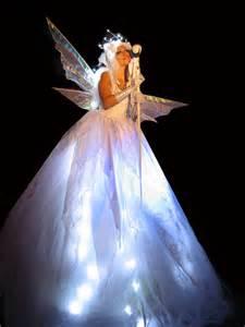 Light Fairies White Stilt Walkers Stiltwalker Stilt Walkers Stilt Performers