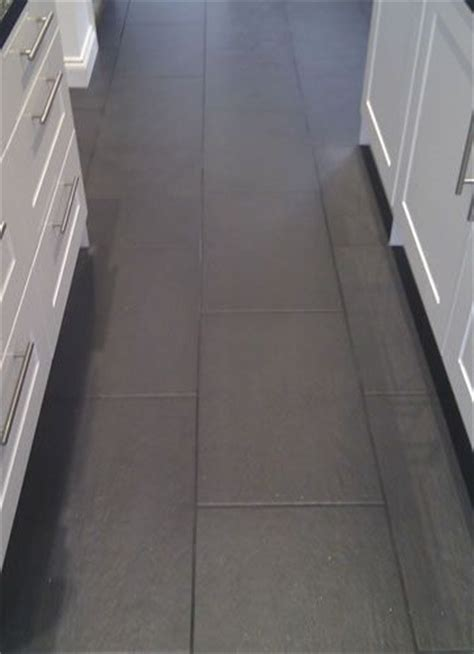 Floor Tiles With Grey Grout by 25 Best Ideas About Tile Floor Kitchen On