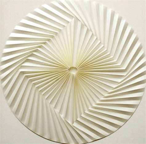 Geometric Paper Folding - artist creates mesmerizing geometric patterns by folding