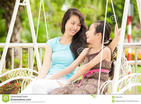 swinging in asia happy family stock photos image 30631333