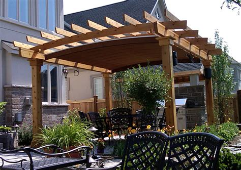 A Retractable Canopy System Custom Fitted Into Arched Pergola Cover