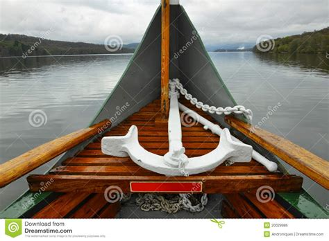 how to anchor a boat in a lake anchor on boat nose on lake in cloudy weather royalty free