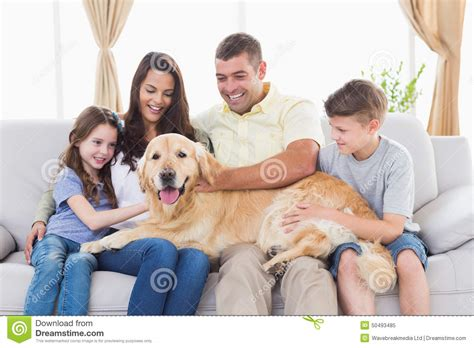 labrador or golden retriever best family dogs family stroking while crouching at park royalty free stock photo cartoondealer