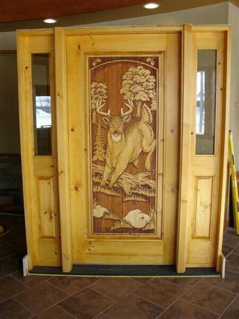 Carved Front Doors Deer Carved In Front Door Ideas For Bryon